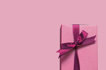 pink love gift box on pink background; valentine gift