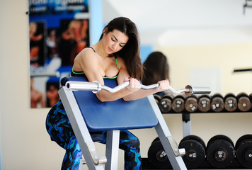 beautiful girl is engaged in the gym