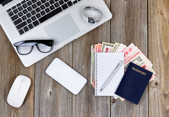 Travel plans on wooden desktop