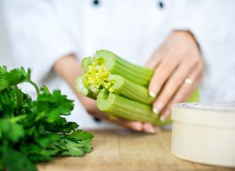chef holding celery