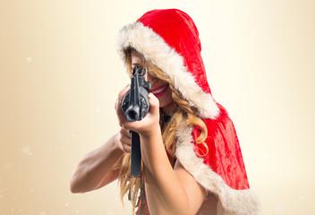 Christmas woman shooting with a pistol