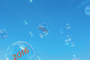 bubbles with the date 2016. Card 2016