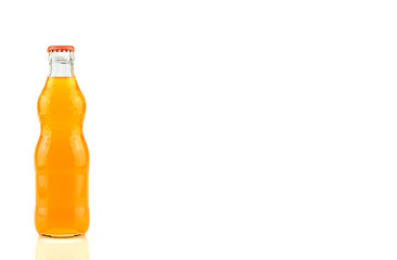 Glass bottle of orange soda isolated on white background