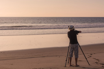 Silhouette Of A Young Photographer