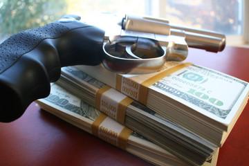Guns and money stock photo