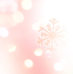 Winter holiday snow flake pink background, bokeh.