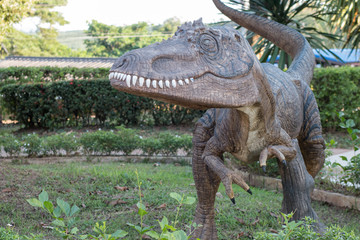 dinosaur statue in park outdoor