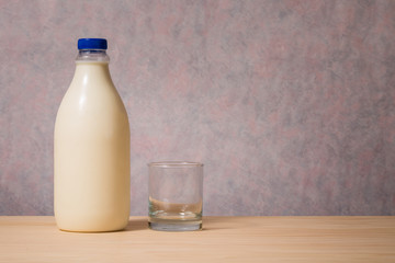 bottle of milk and empty glass