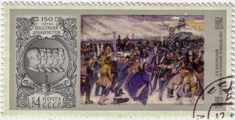 "USSR -CIRCA 1975: A stamp printed in the USSR shows Bas - relief of Decembrists and picture ""Decembrists at the Senate Square"" by D.N. Kardovsky , circa 1975"