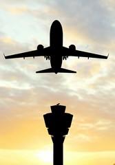 Modern Passenger airplane silhouette flight in sunset