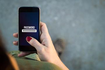 Fototapeta Woman walking smartphone password