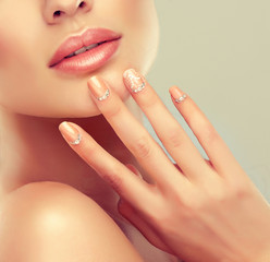Luxury fashion style, manicure nail , cosmetics and make-up . beige nails with rhinestones