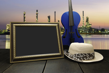 Vintage photo frame on wooden table over cityscape at twilight t