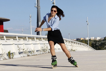woman skater speeding to the right with a skirt