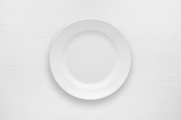 Empty plate on white table top view