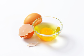Egg white and yolk in glass bowl