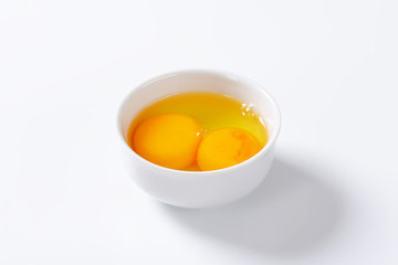 Egg whites and yolks in bowl