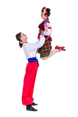 beautiful dancing couple in ukrainian polish national traditional costume clothes jumping, full length portrait isolated
