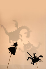 Shadow puppets of Princess and Knight, copy space background.