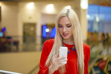 Young beautiful blond woman taking selfie with mobile phone