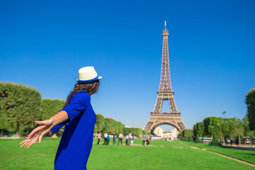 Young woman having fun background Eiffel Tower in Paris