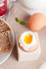 boiled egg, bread and jam for breakfast, vertical, close-up