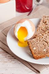 boiled egg, bread and jam for breakfast