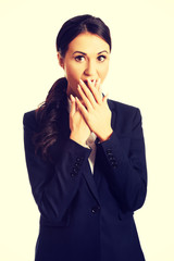 Businesswoman covering her mouth