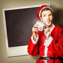 Elf taking christmas photo with santa
