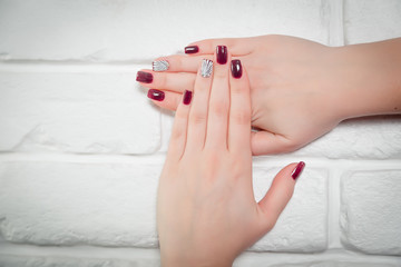 Red nails, shell on the nail, manicure