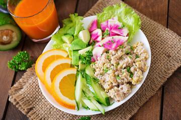 Dietary menu. Breakfast. Oatmeal porridge with vegetables (cucumber, avocado, daikon) and orange