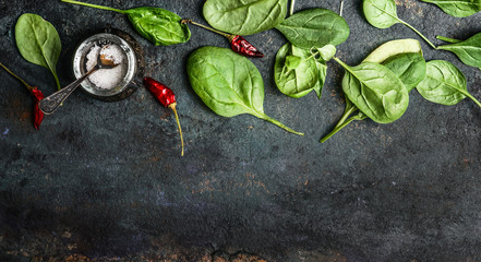 Baby spinach leaves on rustic background, top view, banner . Healthy eating concept