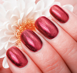 Fototapete - Women's manicure with effect of cat's-eye gel polish on the nail.