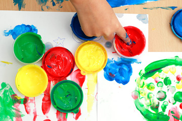 colorful finger paints on a table