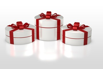 white round gift box with red ribbon