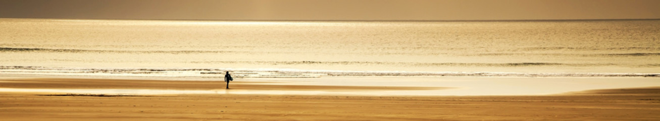 Inspirational surfing landscape panorama, banner of lone surfer