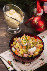 Traditional Russian salad Olivier. New Year food. Christmas background. Selective focus
