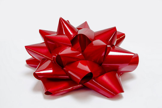Big, shiny, red, bow.