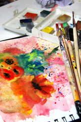 Mix of watercolors and paintbrushes