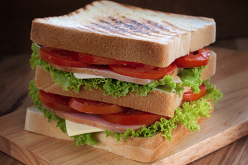 sandwich on wooden board