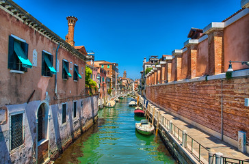 Scenic canal with boats, Venice, Italy, HDR