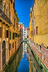 Scenic canal on sunny day, Venice, Italy