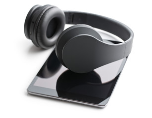 wireless headphones and computer tablet