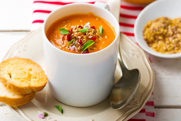 pumpkin soup in a white mug