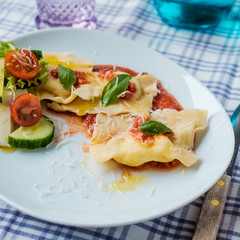 Homemade ravioli with tomatoes