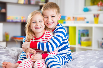 Cute little brother and sister in pajamas