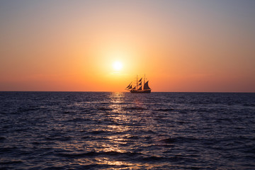 Ship in sea at sunset