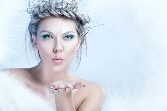 snow queen blowing in her hand