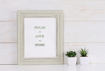 Home, love, family  and happiness concept. Poster in frame shabby chic, vintage style. Scandinavian style home interior decoration.
