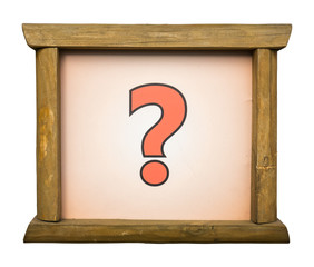 Question mark on board in wooden frame. Concept of problem, solu